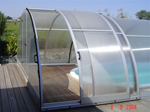 Swimming pool cover with sliding door
